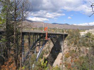 "Painters using ""Snooper"" under Arch Bridge, New Mexico"